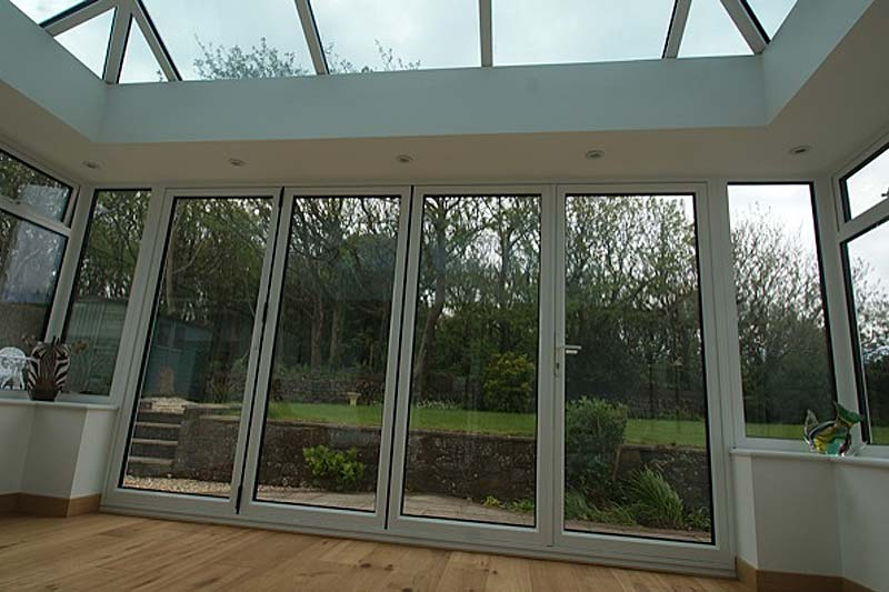 Aluminium bi folding doors diamond glass and windows