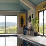 Swimming pool with bi fold door system