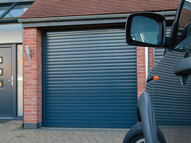 Blue remote controlled roller garage door title=